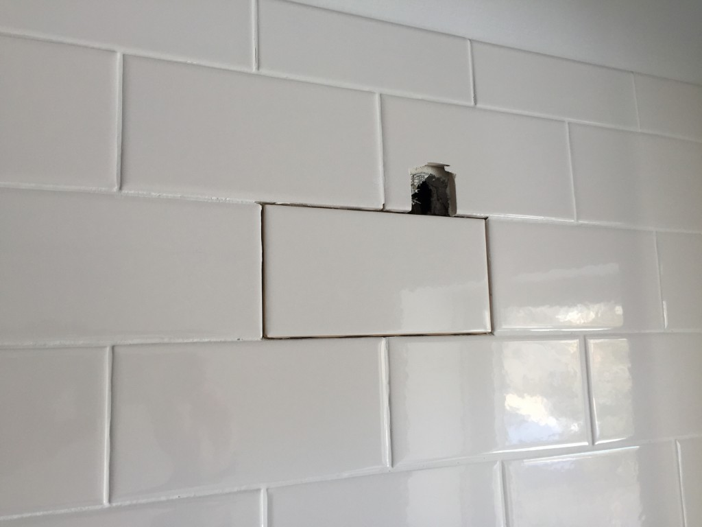 Tile was removed from property by Greg Truskey before the tiler completed the work.  This tile was added in by Greg Truskey  but no grout.